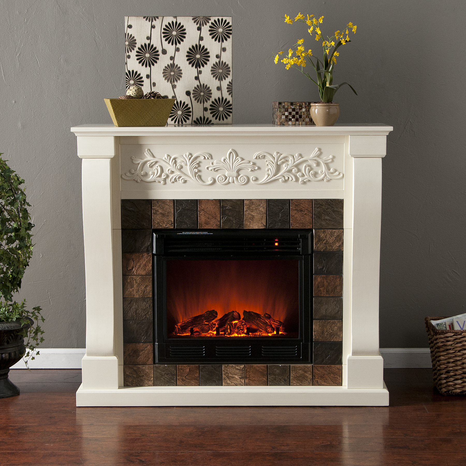 An elegant floral design across the top of Calgary Electric Fireplace-Ivory crisp ivory fireplace draws attention